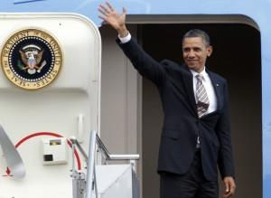 U.S. President Barack Obama waves at the door of Air Force One as he departs from Ngurah Rai international airport in Denpasar, Bali