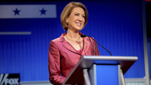 Republican presidential candidate businesswoman Carly Fiorina stands on stage for a pre-debate forum at the Quicken Loans Arena, Thursday, Aug. 6, 2015,  in Cleveland. Seven of the candidates have not qualified for the primetime debate. (AP Photo/Andrew Harnik)