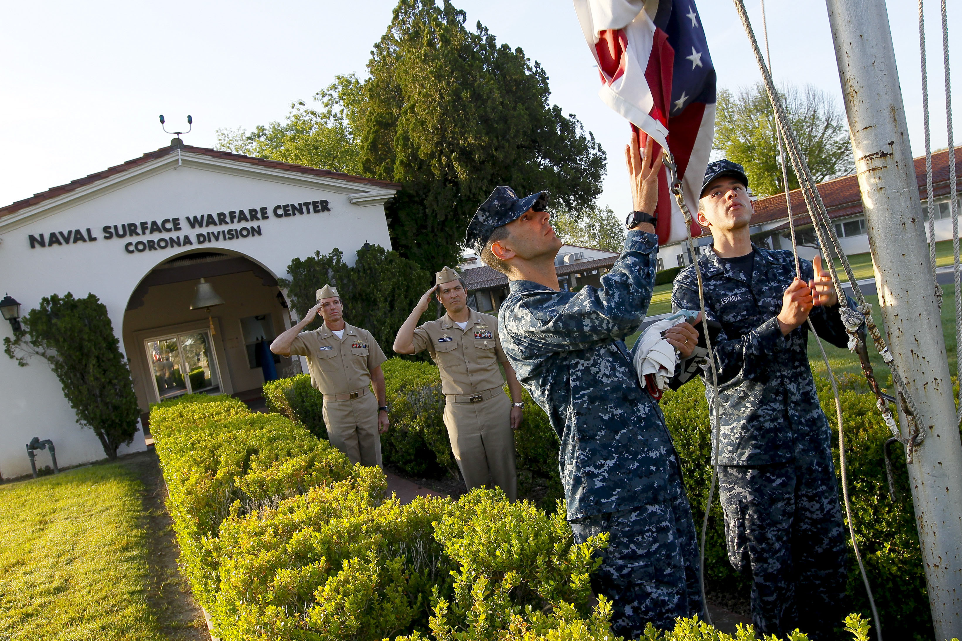 110315-N-HW977-066 NORCO, Calif. (March 15, 2011) Capt. Jay Kadowaki, second from left, commanding officer of Naval Surface Warfare Center (NSWC), Corona Division, and Cmdr. Breck DeGroff, chief of staff of NSWC, salute as Chief Master-at-Arms George LeTourneau, second from right, and Master-at-Arms 3rd Class Eugene Esparza raise the American flag during a morning colors ceremony to honor U.S. Army Cpl. Frank W. Buckles. Buckles, the last surviving American World War I veteran, died Feb. 27, 2011 and will be interred today at Arlington National Cemetery. (U.S. Navy photo by Greg Vojtko/Released)