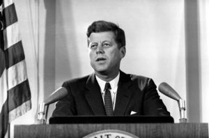 "U.S. President John F. Kennedy reports to the nation on the status of the Cuban crisis from Washington, D.C. on Nov. 2, 1962. He told radio and television listeners that Soviet missile bases ""are being destroyed"" and that U.S. air surveillance would continue until effective international inspection is arranged. U.S. government conclusions about the missile bases, he said, are based on aerial photographs made Nov. 1. (AP Photo)"