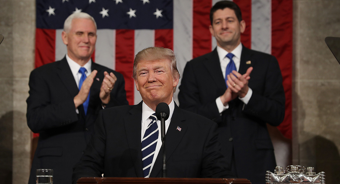 US Vice President Mike Pence (L) and Speaker of the House Paul Ryan (R) applaud as US President Donald J. Trump (C) arrives to deliver his first address to a joint session of Congress from the floor of the House of Representatives in Washington, DC, USA, 28 February 2017. / AFP / POOL / JIM LO SCALZO (Photo credit should read JIM LO SCALZO/AFP/Getty Images)