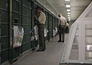 Los Angeles County Sheriff's deputies inspect a cell block at the Men's Central Jail in downtown Los Angeles Wednesday, Oct. 3, 2012. Los Angeles County Sheriff Lee Baca says he plans to implement all the reforms suggested by a commission in the wake of allegations that a culture of violence flourished in his jails. (AP Photo/Reed Saxon)